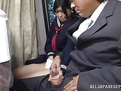 The cute asian schoolgirl got the wrong chair, or perhaps the right one 'coz she is sitting near a pervert. The guy doesn't cares that the buss is filled with people, he just takes out his dick and puts her to jerk him. It looks like the schoolgirl is not so innocent 'coz this little bitch masturbates too!