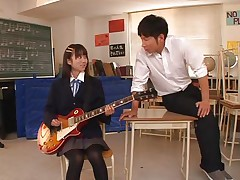 Pretty schoolgirl Asuka is in the classroom, learning to play the guitar. This bitch is more interested in her professor and this chab sees in her a lot of potential but not as a guitar player. She has a lot more talent when it's about a hard wang and gives him one hell of a hand job before bending over in front of him